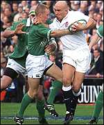 Peter Stringer tackles Phil Greening