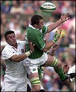 Martin Corry of England battles for the ball with Ireland's Eric Miller