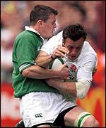 Dan Luger of Ireland is stopped by Brian O'Driscoll