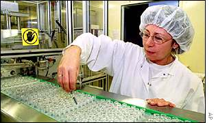 A worker on a pharmaceuticals production line