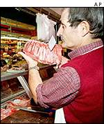 Italian butcher in a market