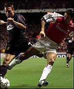 Arsenal's Robert Pires battles for the ball with Mallorca's Akyel Faith