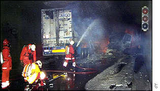 Members of the fire brigade work at the scene of the accident