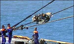 Wreckage being removed from the crash site