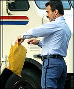 US postal worker holds package