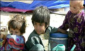 Three refugee children at a refugee camp in the Pakistani border town of Chaman, southwestern Pakistan