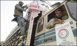 The Red Crescent preparing a lorry of aid in Pakistan