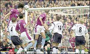 Angel heads Villa's first goal against Bolton