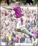 Vassell celebrates his strike
