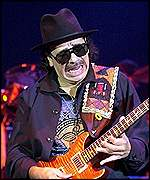 Carlos Santana, seen here playing in Switzerland, contributes to Michael Jackson's track, Whatever Happens