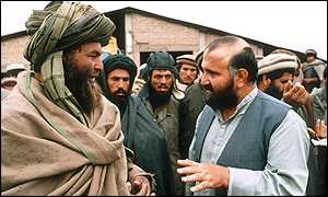 Abdul Haq seen here in a 1992 picture talking to an unidentified field commander