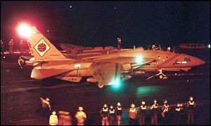 An F-14 Tomcat prepares for takeoff on USS Roosevelt