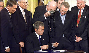 President Bush signs the Bill into law