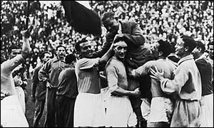 Italy players lift up their coach Vittorio Pozzo after winning the FIFA World Cup Final in 1934