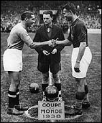 Italy captain Giuseppe Meazza (left) shakes hands with Hungary captain Gyorgy Sarosi (right) before the FIFA World Cup Final played in Paris