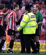 Sunderland players protest with Mike Riley at the final whistle