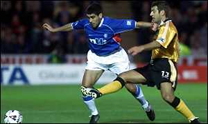 Claudio Reyna holds off the challenge of Davide Xausa of Livingston