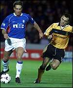 Fernando Ricksen (left) of Rangers gets past Livingston's Francisco Quino