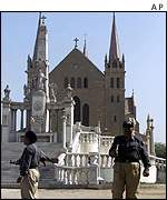 Police stand guard outside Sty Patrikc's church in Karachi