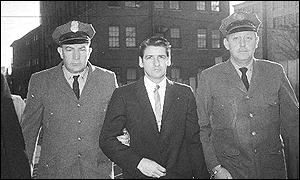 Albert DeSalvo (centre) and police