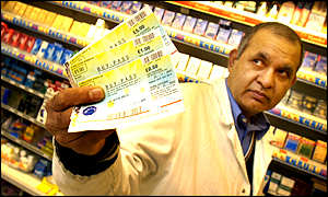 A Glasgow shopkeeper with vouchers used in his shop