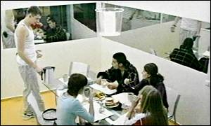 Competitors enjoying a meal inside the Big Brother flat