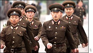 North Korean soldiers march through Pyongyang