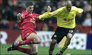 Liverpool's Steven Gerrard dives in on Dortmund's Dede