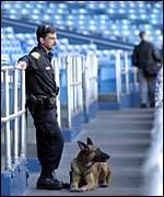 A security office and his patrol dog