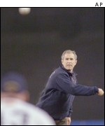 President Bush pitching baseball
