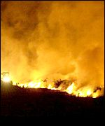 A pyre burns at Arscott Farm near Holsworthy in Devon in late April 2001