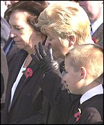 Great-granddaughter Annette Wilkinson with her son Jay and granddaughter June Brammer wipes away a tear