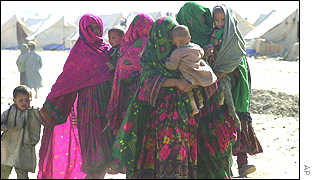 Afghan women refugees cross into a camp at Chaman