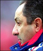 Ossie Ardiles watches from the sidelines