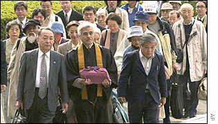 A group of plaintiffs arrives at the Osaka District Court in Osaka, western Japan