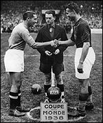 The skippers shake hands before the 1938 final