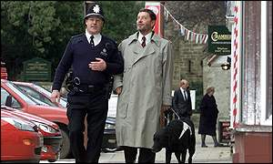 Home Secretary David Blunkett walks the beat with PC Malcolm Young in Bedale, North Yorkshire