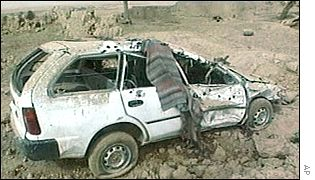 A wrecked car in a bombed village near Kandahar