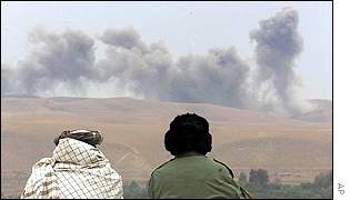 Opposition fighters watch US bombs explode in the Takhar region