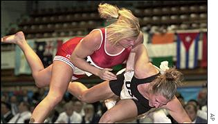 Norway's Linda Holmeide (left) overpowers American Jaclyn Feuerschwenger to win the bout