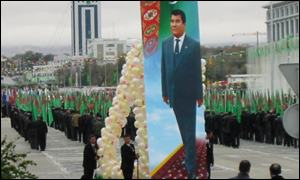 A poster of the president is carried through the streets of Ashgabat during a parade to mark the tenth anniversary of independence from the USSR