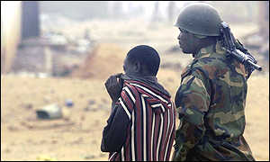 Boy and soldier in Kaduna