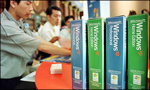 Workers in Malaysia pack Windows XP