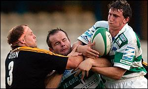 Will Green (right) attempts to take the ball from Treviso prop Pierre Ribbens