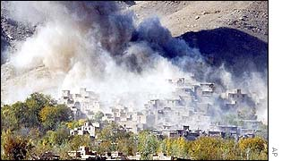 Smoke rising from a village north of Kabul