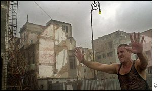 Construction worker guides people away from unsafe buildings in Cuba