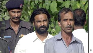 Police take Mohammad Yousaf, middle, and Mohammed Salim, right, for questioning