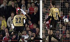 Arsenal's Sylvain Wiltord scores a hat-trick in the opening half against Manchester United in the Worthington Cup
