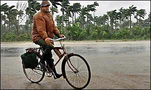 A man struggles with his bike in the town of Jaguey Grande, 100 miles south-east of Havana