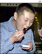 Japanese whaler eating whale meat, AP